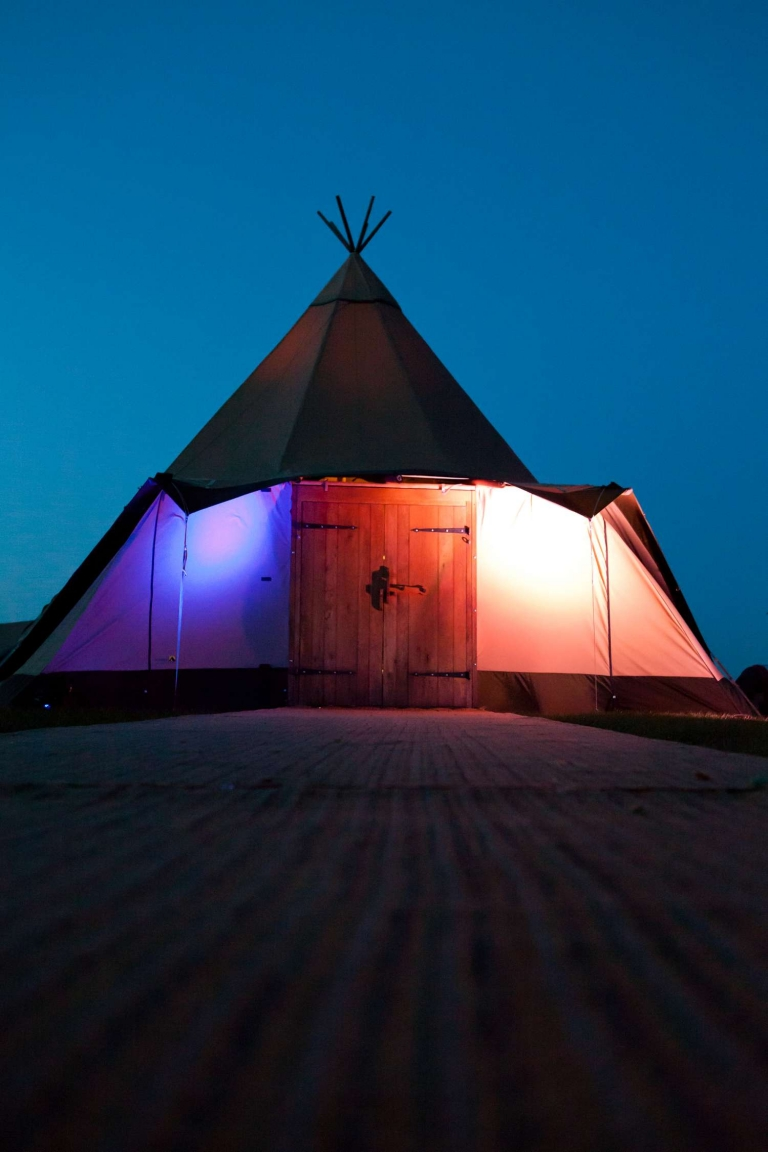 A tipi tent with door as an entrance by the Stunning Tents Company & Featuring The Stunning Tents Company