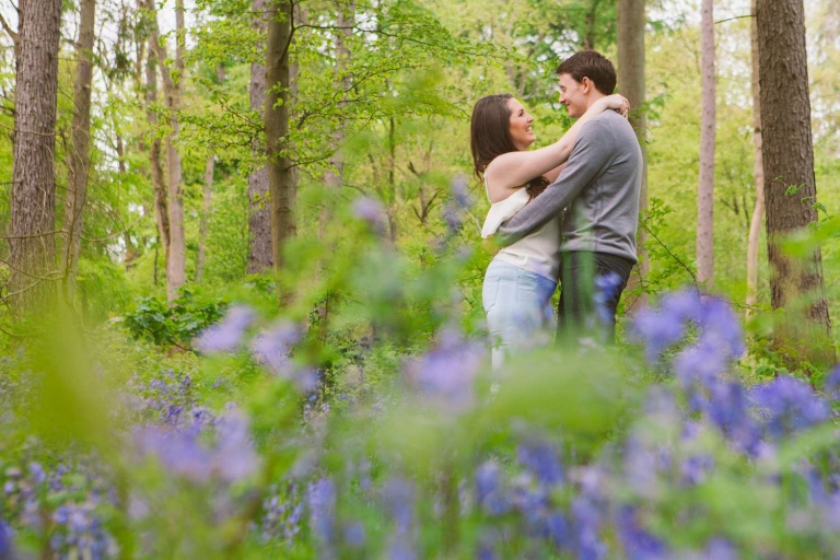 Couple in bluebells during this bluebells engagement shoot