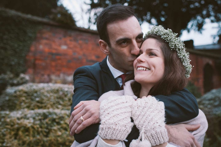 Groom kisses bride during St Albans wedding