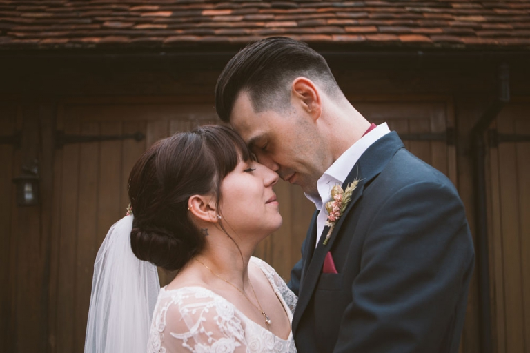 Couple embrace during Denham Court Farm wedding