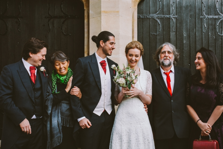 An in between moment during group shots at London wedding photography