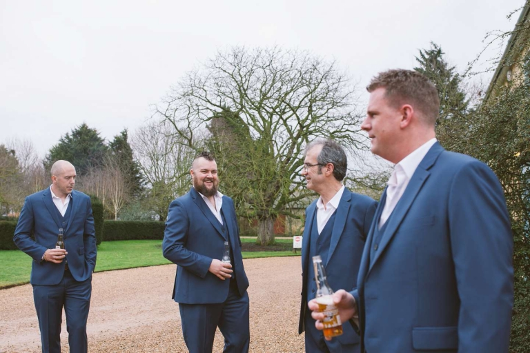Groomsmen having beers at South Farm wedding