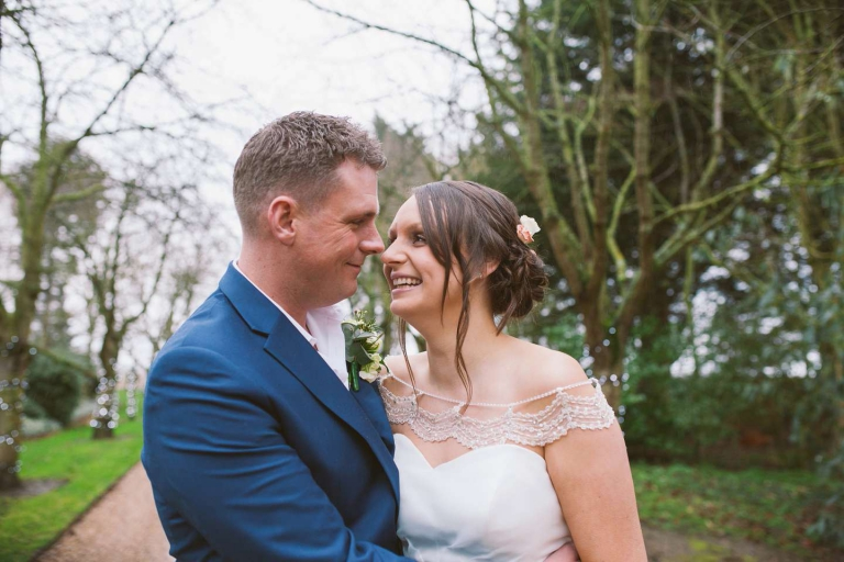 Couple smile on driveway during their rustic South Farm wedding