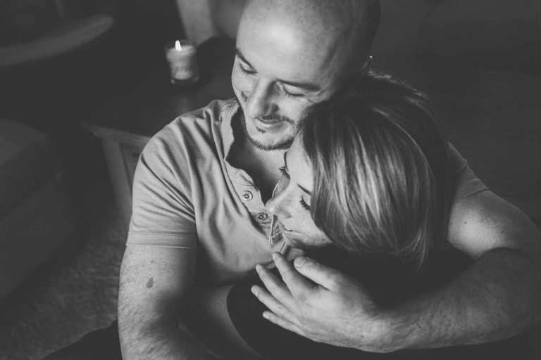 Couple embrace during Watford home engagement shoot
