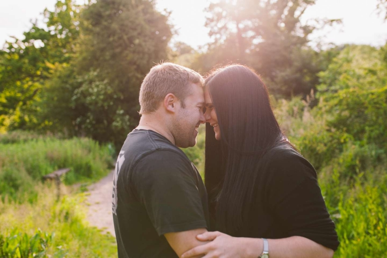 Couple in sunlight during Watford park engagement shoot