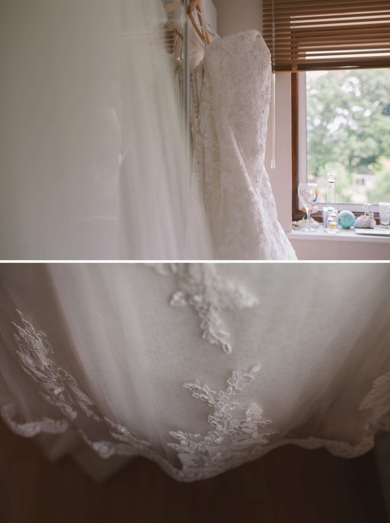 The bride's wedding dress hung up on wardrobe