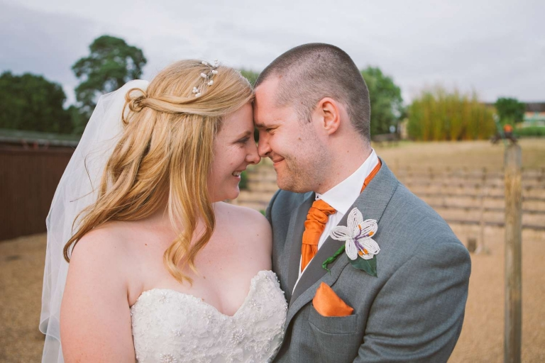 Newlyweds with heads together at Woburn Safari Park wedding