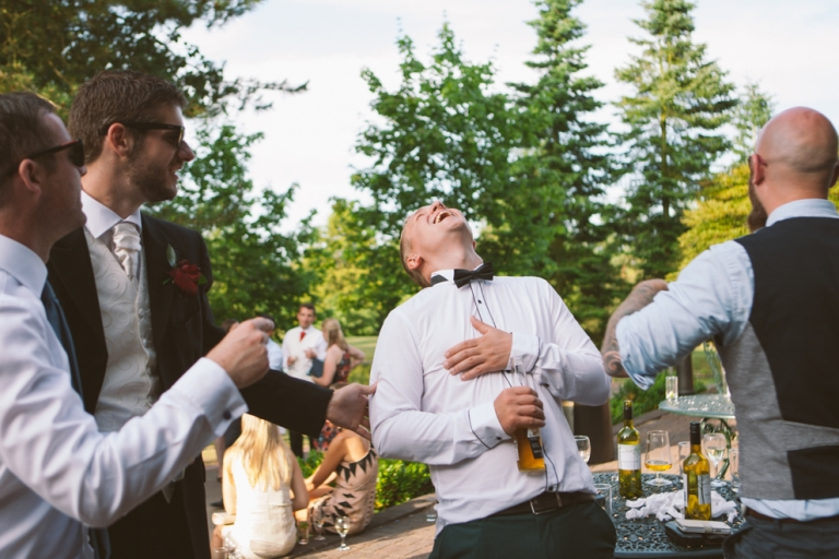 Essendon Country Club wedding photography of guest roaring with laughter
