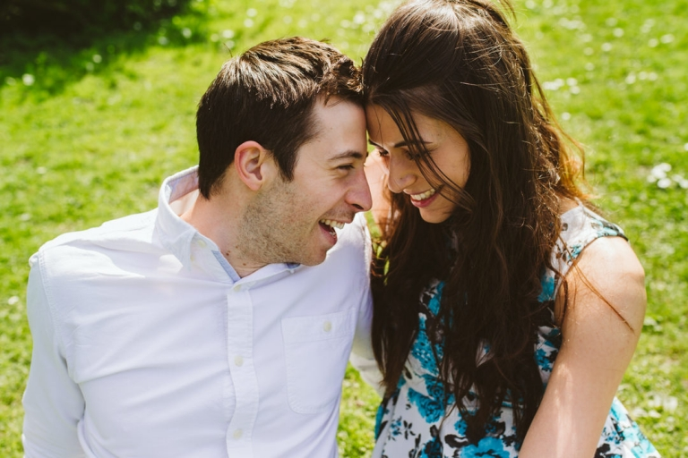 Couple smile in photo for newly engaged advice