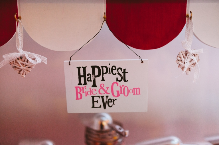 Happiest bride and groom ever sign on sweet cart at Laura Ashley The Manor wedding in Hertfordshire