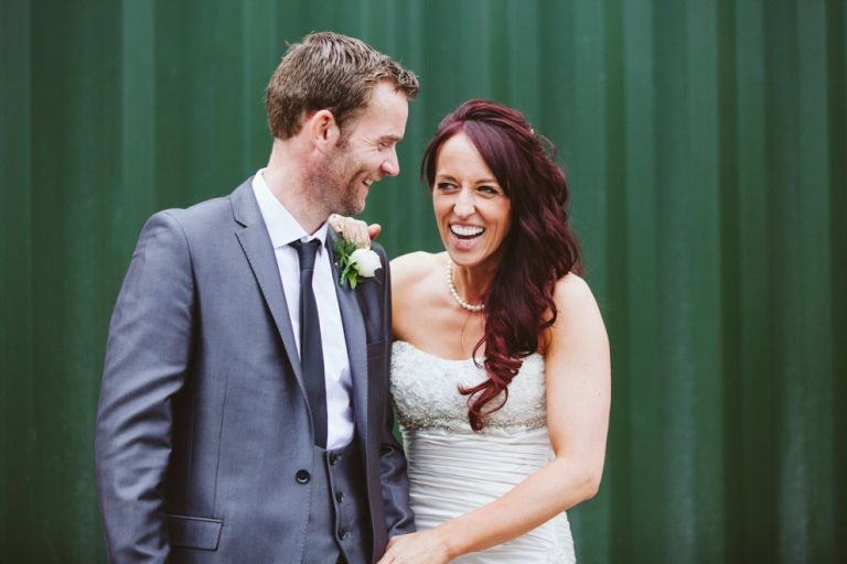 Bride and groom laugh together during wedding in Luton