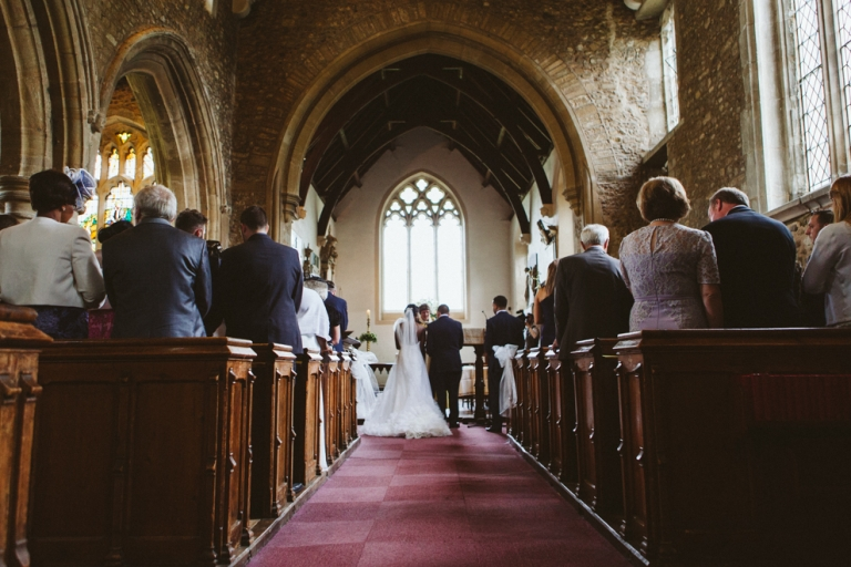 Photos From Back Of Church During Wedding Ceremony