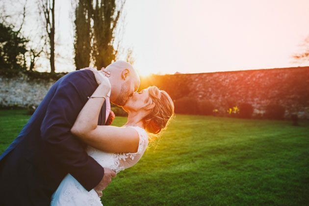 Notley Abbey wedding photography of couple kissing at sunset