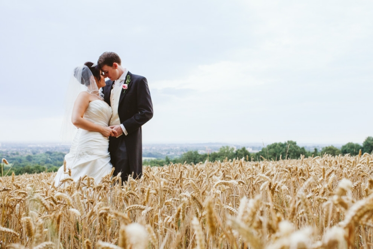 Laura Ashley The Manor wedding of bride and groom in cornfield