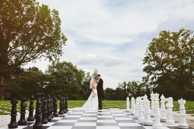 Laura Ashley The Manor Wedding Photography of couple on chessboard