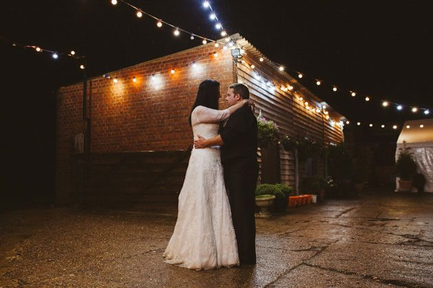 Monkton Barn Wedding Photography of bride and groom in courtyard
