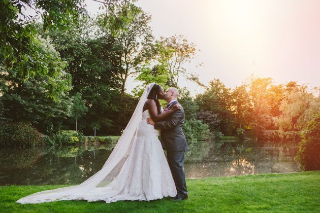 St Michael's Manor wedding photography of couple kissing by lake