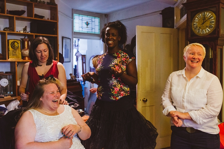 Bride laughing with bridesmaids as getting ready for Stationers Hall wedding