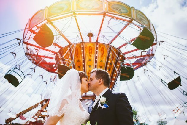 Watford village hall wedding photography of bride and groom at funfair