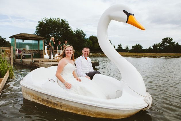Woburn Safari Park wedding photography of couple in swan boat