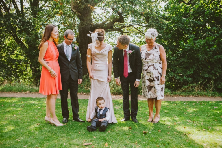 Pageboy protesting on group shot at Pembroke Lodge wedding