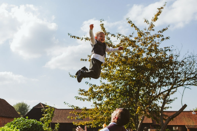 Boy thrown into air at Tewin Bury wedding for kids at weddings post