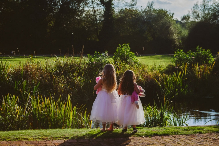 Flowergirls looking at river at Tewin Bury wedding