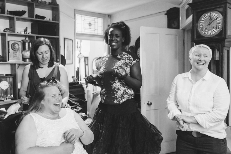 Bride laughs as she gets ready for Stationers' Hall wedding in London