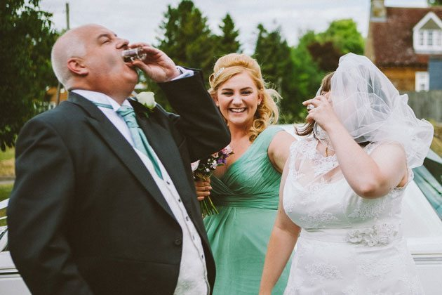Bride and father having a shot before wedding in Northamptonshire