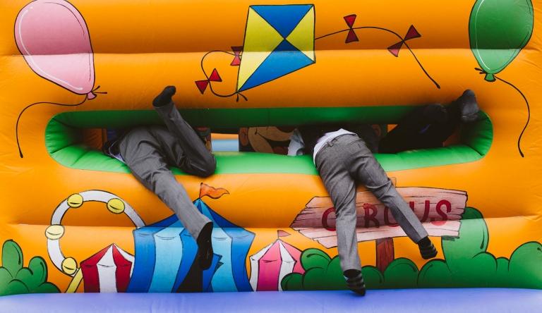 Kids entering bouncy castle at Tewin Bury Farm wedding