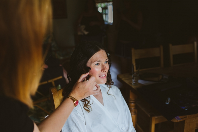 Gate Street Barn Wedding - bride having makeup done by Vicky Brown