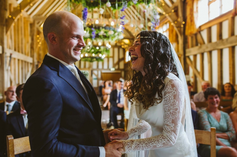 Gate Street Barn Wedding - groom and bride laughing during wedding ceremony