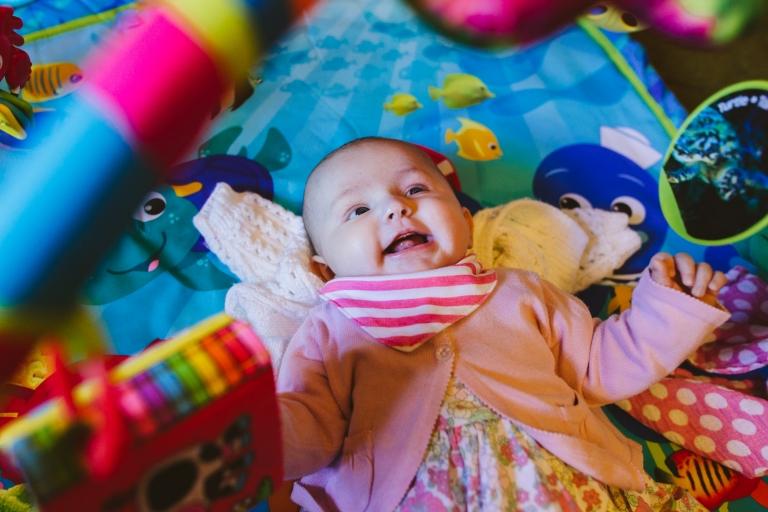 Baby Photoshoot Buckinghamshire - baby playing on playmat