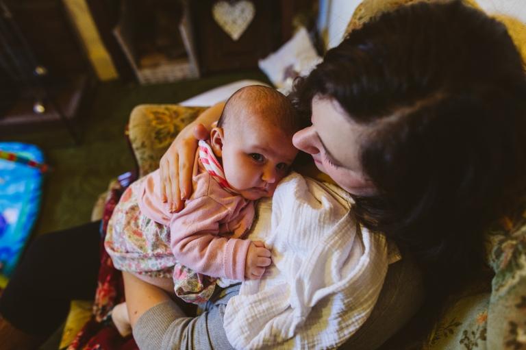 Baby Photoshoot Buckinghamshire - baby being burped by mum