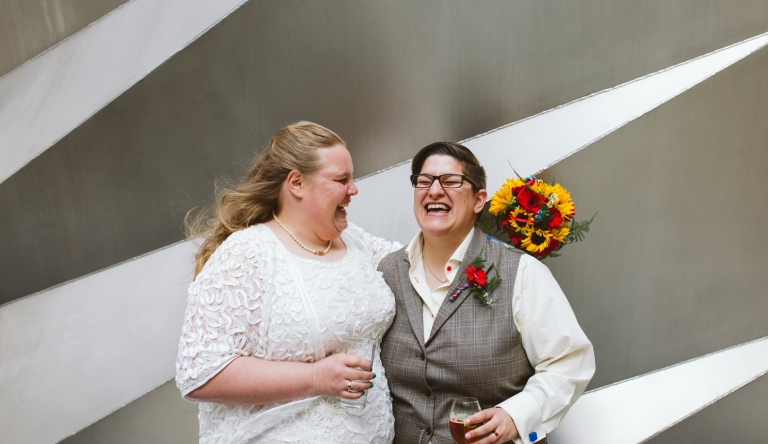 Wedding Photographer Hertfordshire - brides laughing by St Paul's Cathedral