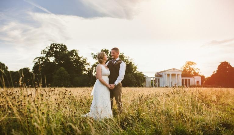 Wedding Photographer Hertfordshire - couple in field during tipi wedding
