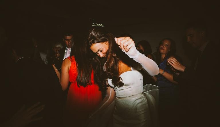 Wedding Photographer Hertfordshire - bride dancing at Monkey Island Hotel wedding