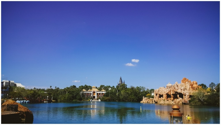 Jurassic Park and Hogwarts Castle seen from across the lake at Universal Island of Adventures
