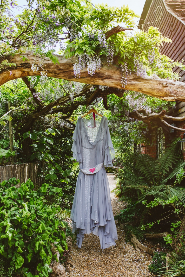 The Couture Company wedding dress hanging from tree in The Bell in Ticehurst