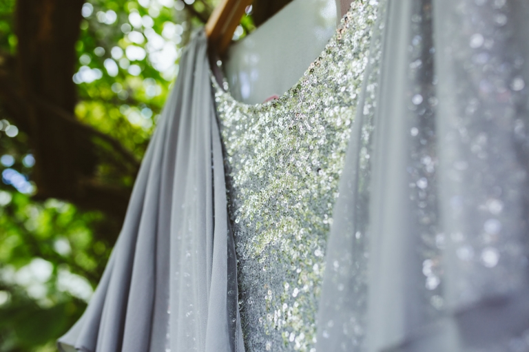 Sequins on The Couture Company wedding dress hanging from tree in The Bell in Ticehurst