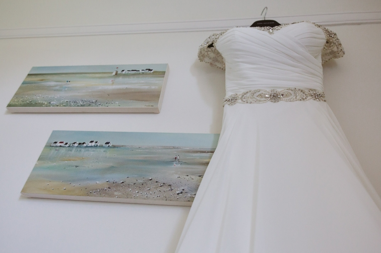 Wedding dress hanging on wall from The Wedding Gallery
