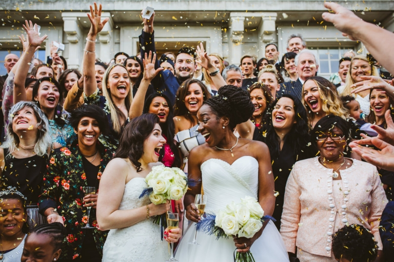 Confetti is thrown at the brides on Hackey Town Hall steps in best of 2017 wedding photography