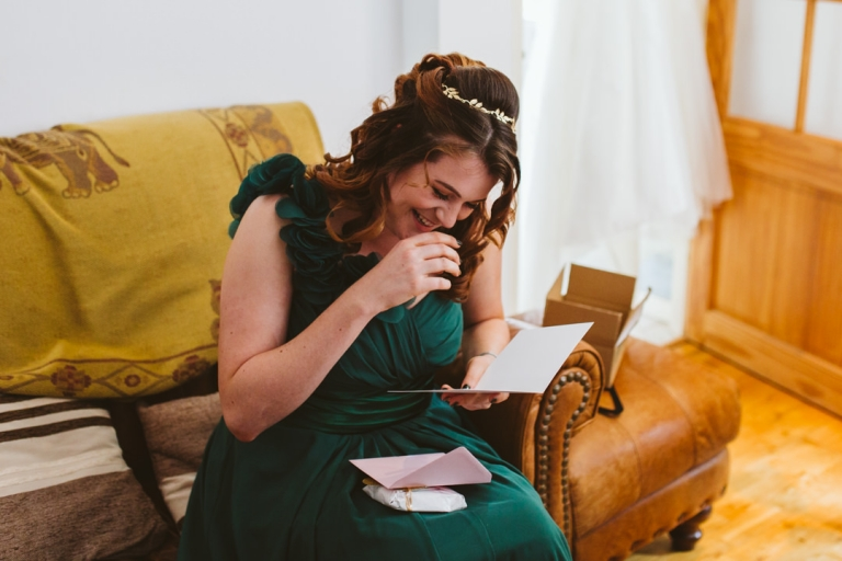 Bridesmaid Laughs Whilst Reading Card From Bride