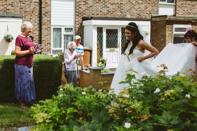Neighbours come out to see bride leaving for wedding