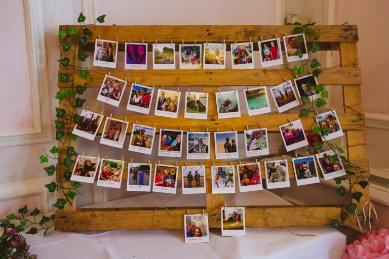 Wooden pallet with polaroid photos of bride and groom on