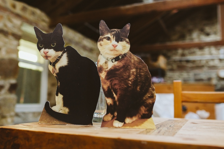 Cutout boards of the bride and groom's cats at High House Farm Brewery wedding