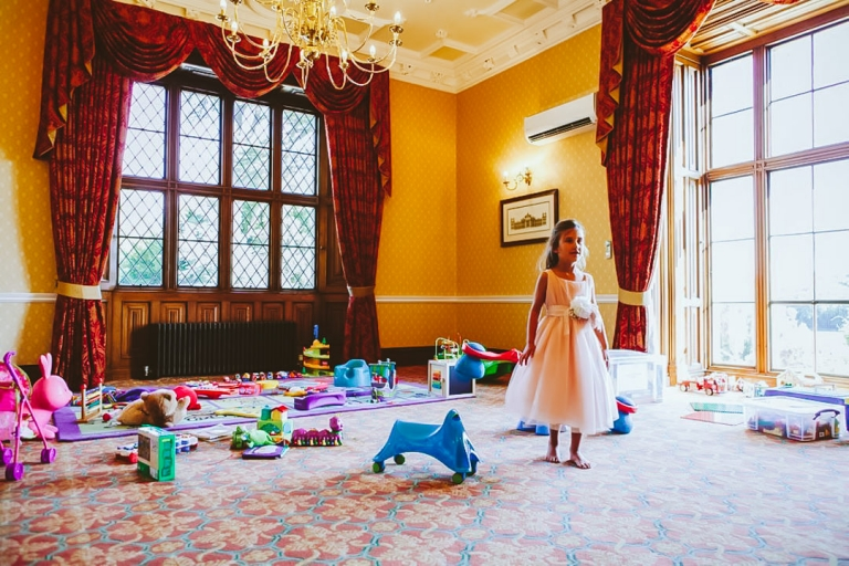 Bridesmaid amongst toys by wedding day creche
