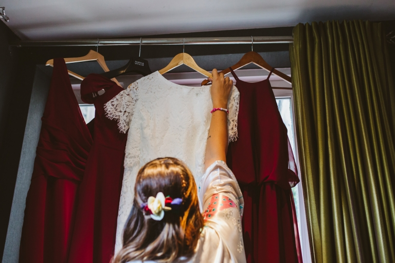 Bride reaches for her two piece wedding dress