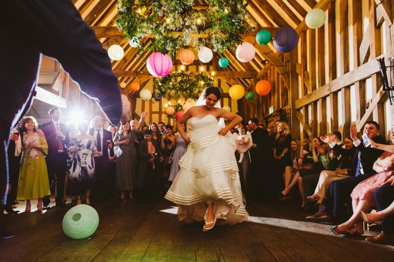 Bride dancing under hanging lanterns at Gate Street Barn wedding