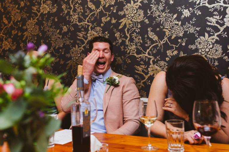 Bridal party laughing during speeches for best wedding photography 2018